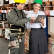 Supervisor And Foreman Using Digital Tablet at Warehouse — Foto de Stock