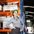 Female Supervisor Wearing Protective Eyeglasses At Warehouse — Stock Photo