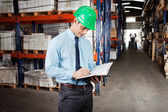 Supervisor Writing Notes At Warehouse — Stock Photo