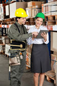 Supervisor And Foreman Using Digital Tablet at Warehouse — Stock Photo