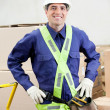 Confident Foreman In Protective Clothing Standing At Warehouse — Stock Photo #14536171