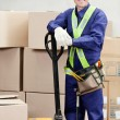 Portrait Of Confident Warehouse Worker - Stock Photo