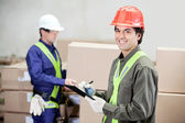 Supervisor Writing Notes Clipboard While Foreman Working At Ware — Stock Photo