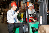 Supervisor With Clipboard Instructing Forklift Driver — Stock Photo