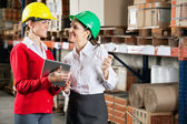 Female Supervisors Discussing Work At Warehouse — Stock Photo