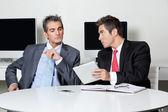 Businessmen Using Digital Tablet At Desk — Stock Photo