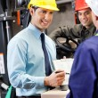 Male Supervisor Showing Clipboard To Foreman — Stock Photo