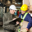 Stock Photo: Supervisor Showing Clipboard To Foreman