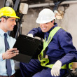 Supervisor Showing Clipboard To Forklift Driver — Stock Photo