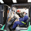Stock Photo: Forklift Driver Communicating With Colleague