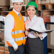 Two Young Supervisors At Warehouse — Stock Photo #14542811