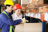 Supervisor And Foreman Checking Stock At Warehouse — Stock Photo