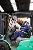 Forklift Driver Communicating With Colleague — Stock Photo