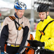 Courier Delivery Men With Bicycles Using Digital Tablet — Stock Photo #15427091