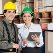 Supervisor Instructing ForemAt Warehouse — Stock Photo #15427171