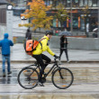 Male Cyclist With Backpack On Street - Foto Stock