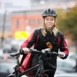 Female Cyclist With Courier Bag On Street — Stock Photo