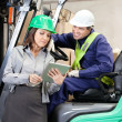 Female Supervisor And Forklift Driver Using Digital Tablet — ストック写真