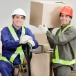 Stock Photo: Foremen Loading Cardboard Boxes At Warehouse