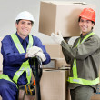 Foremen Loading Cardboard Boxes At Warehouse - Stock Photo