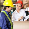 Supervisor Showing Clipboard To Foreman — Stock Photo #15428153