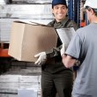 Foreman Looking At Supervisor With Clipboard — Stock Photo #15428373
