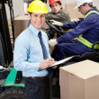 Supervisor With Foremen Working At Warehouse — 图库照片