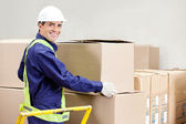 Foreman Holding Cardboard Box in Warehouse — Stock Photo