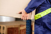 Foreman Carrying Cardboard Box At Warehouse — Stockfoto