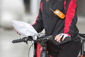 Female Cyclist Holding Courier Package — Stock Photo