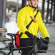 Young Man With Bicycle And Bag Looking Away — Stock Photo