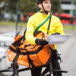 Male Cyclist With Package And Courier Bag On Street — Stock Photo #15441413