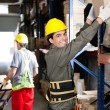 Постер, плакат: Foreman With Coworker Working At Warehouse