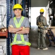Mid Adult Foreman With Arms Crossed At Warehouse — Stock Photo #15442113