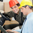 Stock Photo: Forklift Driver With Supervisor Using Laptop