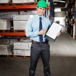 Confident Supervisor Displaying Clipboard — Stock Photo