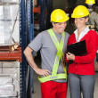 Happy Supervisor Showing Clipboard To Foreman — Stock Photo