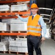 Confident Supervisor Showing Stock On Shelves — Stock Photo
