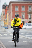 Cyclist With Courier Bag Using Walkie-Talkie — 图库照片