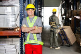 Mid Adult Foreman With Arms Crossed At Warehouse — Stock Photo