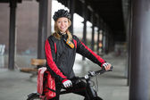 Female Cyclist With Courier Bag — Stock Photo