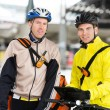 Courier Delivery Men With Bicycles Using Digital Tablet — Stock Photo #15541841