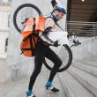Courier Delivery Man With Bicycle And Backpack Walking Up Stairs — Stock Photo