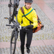 Male Cyclist With Bicycle And Courier Bag Walking Up Steps — Stock Photo