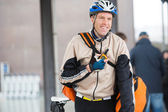 Male Cyclist With Courier Bag Using Walkie-Talkie — Stock Photo