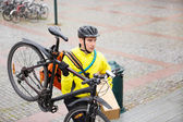 Courier Delivery Man With Package And Bicycle Walking Up Steps — Stock Photo
