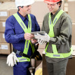 Foremen Using Digital Tablet in Warehouse — Stock Photo