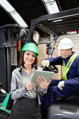 Female Supervisor And Forklift Driver With Digital Tablet — Stock Photo