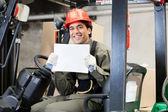 Forklift Driver Displaying Blank Placard — Stock Photo