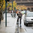 Male Cyclist Using Walkie-Talkie On Street — Stock Photo #15610263